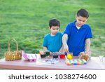 brothers coloring easter eggs | Shutterstock . vector #1038274600