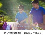 brothers coloring easter eggs | Shutterstock . vector #1038274618