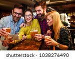 friends at the bar drinking... | Shutterstock . vector #1038276490