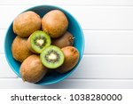 halved kiwi fruit in bowl. | Shutterstock . vector #1038280000