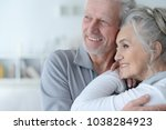 happy senior couple at home | Shutterstock . vector #1038284923