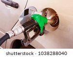 grey car at gas station being... | Shutterstock . vector #1038288040