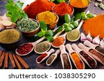 variety of spices and herbs on... | Shutterstock . vector #1038305290