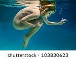 nude beautiful girl is under... | Shutterstock . vector #103830623