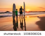 father and son surfers stay on... | Shutterstock . vector #1038308326