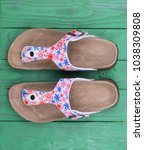 Small photo of Women's sandals on flat soles with floral prints