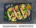 roasted coconut cauliflower... | Shutterstock . vector #1038315223