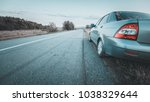 the car on the roadside highway   Shutterstock . vector #1038329644