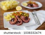 macro close up of octopus... | Shutterstock . vector #1038332674