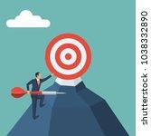 businessman climbs uphill with...   Shutterstock .eps vector #1038332890