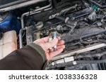 replacing ignition coil and... | Shutterstock . vector #1038336328