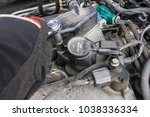 removing ignition coil and... | Shutterstock . vector #1038336334