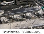 ignition coil and spark plugs... | Shutterstock . vector #1038336598