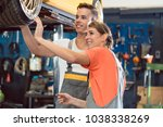 two dedicated auto mechanics... | Shutterstock . vector #1038338269