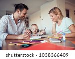 mom and dad drawing with their... | Shutterstock . vector #1038366409