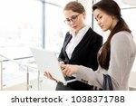 multi ethnic team of hard... | Shutterstock . vector #1038371788