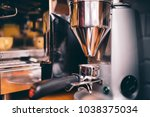 Small photo of Professional coffee milling machinery preparing for espresso making