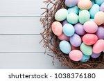 pastel easter eggs background.... | Shutterstock . vector #1038376180