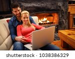 smiling couple with laptop... | Shutterstock . vector #1038386329
