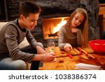 young boy and his sister having ... | Shutterstock . vector #1038386374
