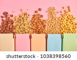 colorful boxes of cornflakes or ... | Shutterstock . vector #1038398560