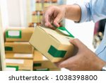 employees are packing a parcel... | Shutterstock . vector #1038398800