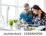 cute creative designers working ... | Shutterstock . vector #1038404500
