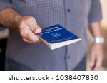 man holding the brazilian work... | Shutterstock . vector #1038407830