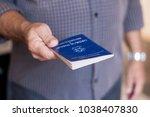 man holding the brazilian work... | Shutterstock . vector #1038407830