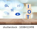 Small photo of Internet of things concept, IOT on wooden cubes and inter net of thing icon over blur background, technology and lifestyle