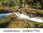 waterfall in chiang mai thailand | Shutterstock . vector #1038417793