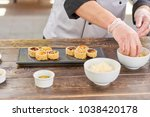 chef hands putting ginger from... | Shutterstock . vector #1038420178