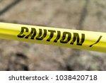 caution tape outdoors danger | Shutterstock . vector #1038420718