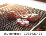 steak and rib are cooking on... | Shutterstock . vector #1038421438