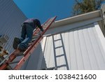 escalating risks of a worker by ... | Shutterstock . vector #1038421600
