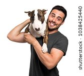 Stock photo young man holding his dog friend 1038425440
