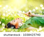 beautiful young woman lying on... | Shutterstock . vector #1038425740