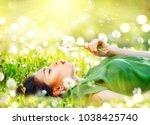 beautiful young woman lying on... | Shutterstock . vector #1038425740