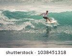 image of surfer on blue ocean...   Shutterstock . vector #1038451318