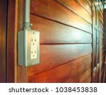 Small photo of Outlet electrify plug / socket on the wooden wall.