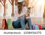 happy attraction asian woman... | Shutterstock . vector #1038456370