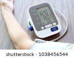 human check blood pressure... | Shutterstock . vector #1038456544