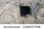 abandoned mine portal entrance... | Shutterstock . vector #1038457408