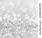 silver background with sparkles | Shutterstock . vector #1038458359