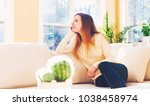 young woman relaxing on a couch ... | Shutterstock . vector #1038458974