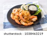 fried shrimps or prawns with... | Shutterstock . vector #1038463219