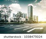 asphalt road and modern city | Shutterstock . vector #1038475024
