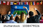 frieds cheering sport at bar... | Shutterstock . vector #1038479026