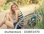 Beautiful Smiling Girl Sitting...