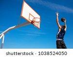 young basketball street player...   Shutterstock . vector #1038524050